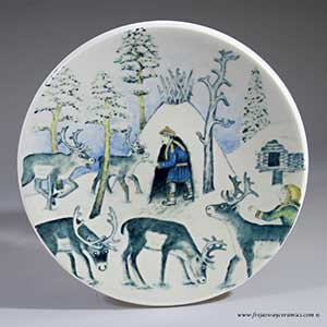 From Arabia of Finland, a small plate depicting a reindeer keeper in winter from 1982