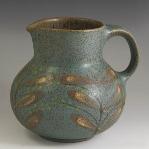 dybdahl uncovered creamer leaf pattern on breen-blue background