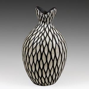 Black and white  vase  with sgraffito decoration ofdark lines cut into the thick white overglaze