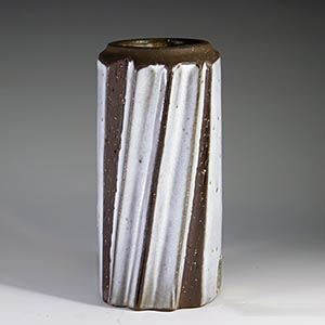 michael andersen reversible vase/candleholder in raw clay and heavy white glaze with a pattern spiraling around the body unnumbered