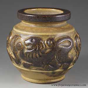 michael andersen & son ball vase decorated in relief with lions.