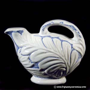 michael andersen and son blue and white floral design jug with a poring spout and a handle
