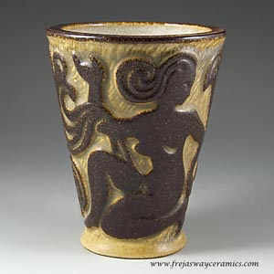 michael andersen and son's rustic-looking cup with a motif of female figures