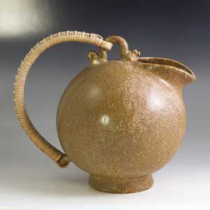 arne bang pitcher with a wicker handle marked 151