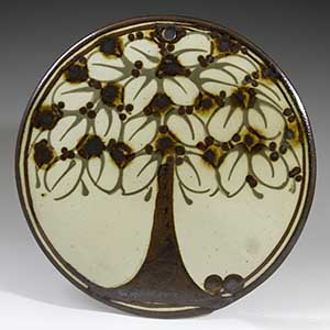 Wall plate with a decorative tree by Erling & Karin Heerwagen