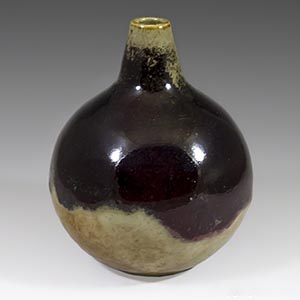 Hoganas ball vase in oxblood aand tan glaze. Unknown artist