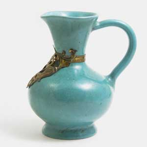 jade green ewer with a metal collar