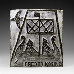 Wall plaque/relief by Haakon Darger depicting a Viking boat under sail.