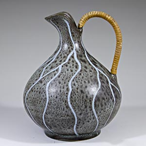 unknown maker grey pitcher with white streaks and a raffia handle