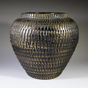 unmarkedwidemouthed vase incised with a metallic sheen