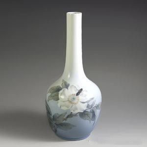 royal copenhagen art nouveau vase decorated with a white flower with a bee hovering over it number 1659 43 B