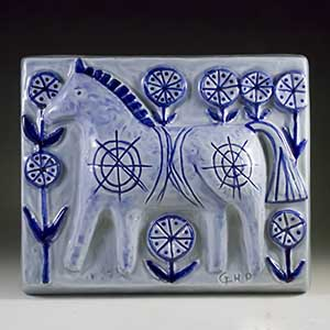 soholf relief in blue and white by gerd hjort petersen featuring a horse number 3520