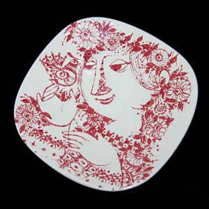wiinblad plate in red and white featuring a woman holding a bird